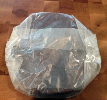 To freeze, I wrap the completely cooled cake in waxed paper, then I wrap it in foil, and then I place it, gently, in a plastic bag.