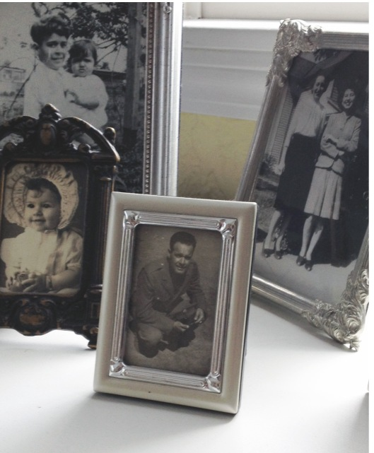 My father in uniform during the Second World War. The photo in the rear, to the left, shows him as a young boy holding his baby sister.